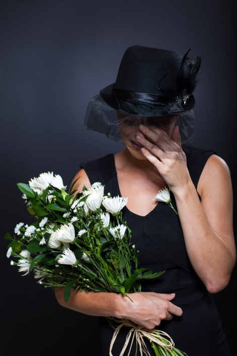 widow crying at funeral